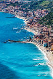 Aerial view Sicily, Mediterranean Sea and coast. Taormina, Italy. Fabulous aerial view of Sicily and the Mediterranean Sea. On the coast you can see the small Stock Photo