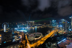Aerial view of Singapore business district and city at night in Stock Images
