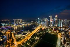 Aerial view of Singapore business district and city at twilight Stock Images