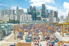 Aerial view of Singapore cargo container port and Singapore city Stock Images