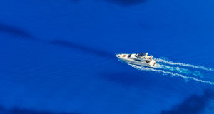 Aerial view of single yacht in azure sea royalty free stock photo
