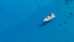 Aerial view of single yacht in azure sea Royalty Free Stock Photos