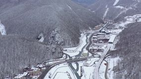 Aerial view of ski resort Gorky Gorod in Caucasus Mountains, Sochi, Russia. Mountain roads from above. Drone shot in 4K stock video footage