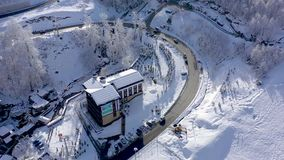 Aerial view of ski resort Gorky Gorod in Caucasus Mountains, Sochi, Russia. Residential buildings and hotels from above. Drone shot in 4K stock video footage