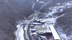 Aerial view of ski resort Gorky Gorod in Caucasus Mountains, Sochi, Russia. Residential buildings and hotels from above. Drone shot in 4K stock video