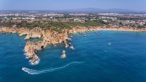 Aerial. View from the sky of coast of Portimao. Beaches Submarino, and praia Joao de Arens. Royalty Free Stock Images