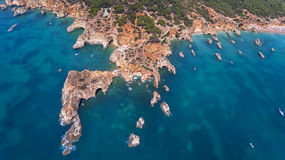 Aerial. View from the sky of coast of Portimao. Beaches Submarino, and praia Joao de Arens. Royalty Free Stock Photo