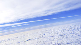 Aerial view: the sky between two layers of clouds Stock Photos