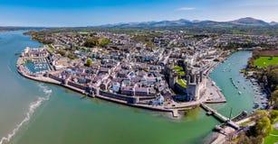 Skyline of Caernafon, Gwynedd in Wales - United Kingdom. Aerial view of the skyline of Caernafon with the historic castle, Gwynedd in Wales - United Kingdom royalty free stock photo