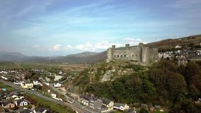 Aerial view of the skyline of Harlech with it`s 12th century castle, Wales, United Kingdom.  stock footage