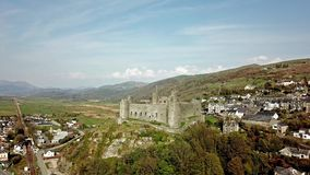 Aerial view of the skyline of Harlech with it`s 12th century castle, Wales, United Kingdom.  stock video