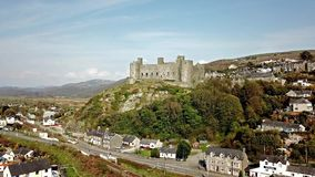 Aerial view of the skyline of Harlech with it`s 12th century castle, Wales, United Kingdom.  stock video footage