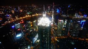 Aerial view of skyscraper with river in Shanghai at night,Chin,panorama shot. stock video footage