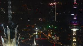 Aerial view of skyscraper rooftop crown at night,shipping & urban traffic. stock footage