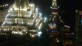 Aerial view of skyscraper rooftop crown with river in Shanghai at night,China. stock footage