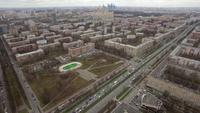 Aerial view of sleeping buildings and complexes with yard and playground. Aerial view of typical modern sleeping district with residential buildings and stock footage