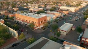 Aerial view sliding left over the downtown urban city skyline in Winslow Arizona