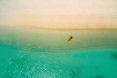 Aerial view of slim woman swimming on the swim mattress in the transparent turquoise sea in Seychelles. Summer seascape with girl royalty free stock photos
