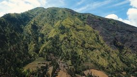 Mountain landscape.Jawa island, Indonesia. Aerial view Slopes of mountains covered with green tropical forest.Jawa island, Indonesia. High mountain forest with Royalty Free Stock Photo
