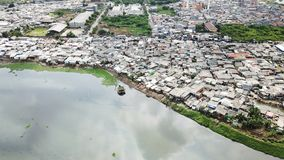 Aerial view of slum neighborhood on lakeside Royalty Free Stock Image