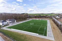 Aerial view of a smal sports soccer football field in a village near andernach koblenz neuwied in Germany. Aerial view of a smal sports soccer football field in royalty free stock image