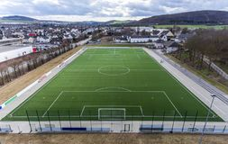 Aerial view of a smal sports soccer football field in a village near andernach koblenz neuwied in Germany. Aerial view of a smal sports soccer football field in royalty free stock photo