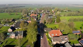 Aerial view small beautiful village in Holland. Flying over the roofs of houses and streets of a small village in. Holland stock video