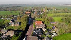 Aerial view small beautiful village in Holland. Flying over the roofs of houses and streets of a small village in. Holland stock footage