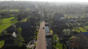 Aerial view small beautiful village in Holland. Flying over the roofs of houses and streets of a small village in. Holland stock video footage
