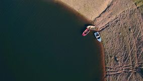 Aerial View Small Boats Moored on Shore stock footage