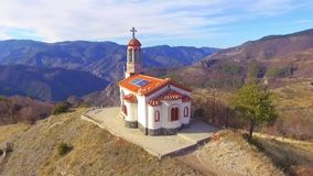 Chapel Ascension of Jesus in Bulgaria. Aerial view of a small chapel in the Rhodope mountains, Bulgaria. Amazing landscape view of the area stock video footage