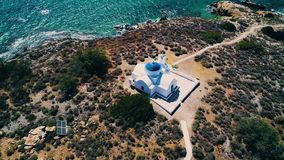 Aerial view of small church at island. Greece stock video