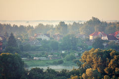 Aerial view of the small countryside at the river coast in the forest Stock Photos