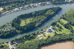 Aerial view : Small island in a river. With a boat Stock Image