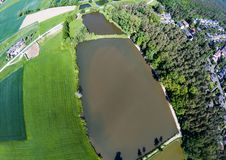 Aerial view of a small lake in the district of Buechenbach of the city of Erlangen Stock Image