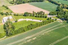 Aerial view of a small parking lot wiping rows of bushes and trees in front of the edge of an arable land. Near Wolfsburg Royalty Free Stock Photography