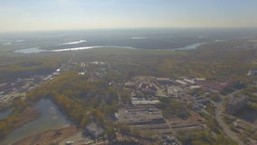 Aerial view of small provincial town in Russia. Drone aerial view of Moskva river near Dzerzhinskiy, Russia stock footage