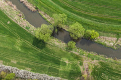 Aerial view of the small river and the harvest field Royalty Free Stock Photo