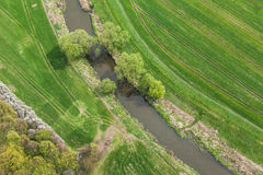 Aerial view of the small river and the harvest field Royalty Free Stock Images