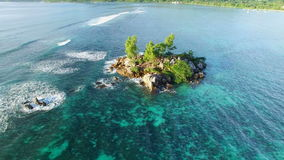 Aerial view of small rocky island on Anse Royale beach on Mahe Island, Seychelles. The tropical paradise of Seychelles Islands from bird's perspective stock video