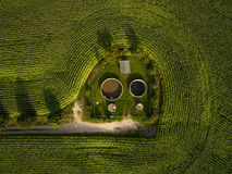 Aerial view  of small sewage treatment plant betwenn corn plants fields - top view Stock Images