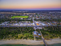 Aerial view of small shopping centre in Seaford and Nepean Highway at dusk. Melbourne, Victoria, Australia. Aerial view of small shopping centre in Seaford and royalty free stock photo