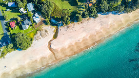 Aerial view on small suburb on a sunny ocean beach. Coromandel peninsula, New Zealand Royalty Free Stock Photo