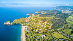 Aerial view on small suburb on a sunny ocean beach. Coromandel peninsula, New Zealand Royalty Free Stock Photography