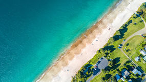 Aerial view on small suburb on a sunny ocean beach. Coromandel peninsula, New Zealand Royalty Free Stock Images