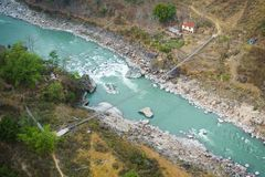 Aerial view of small suspension bridge in Nepal royalty free stock photos