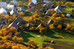 Aerial view on small town - colorful fields and trees in autumn, Royalty Free Stock Photos