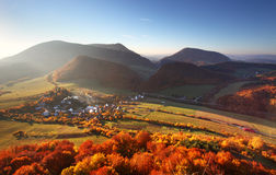 Aerial view on small town - colorful fields and trees in autumn, Royalty Free Stock Images