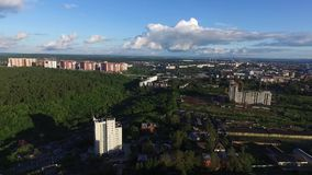 Aerial view of small town near forest. Clip. Green city in summer, Sunny beautiful day.  stock footage