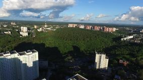 Aerial view of small town near forest. Clip. Green city in summer, Sunny beautiful day.  stock video footage